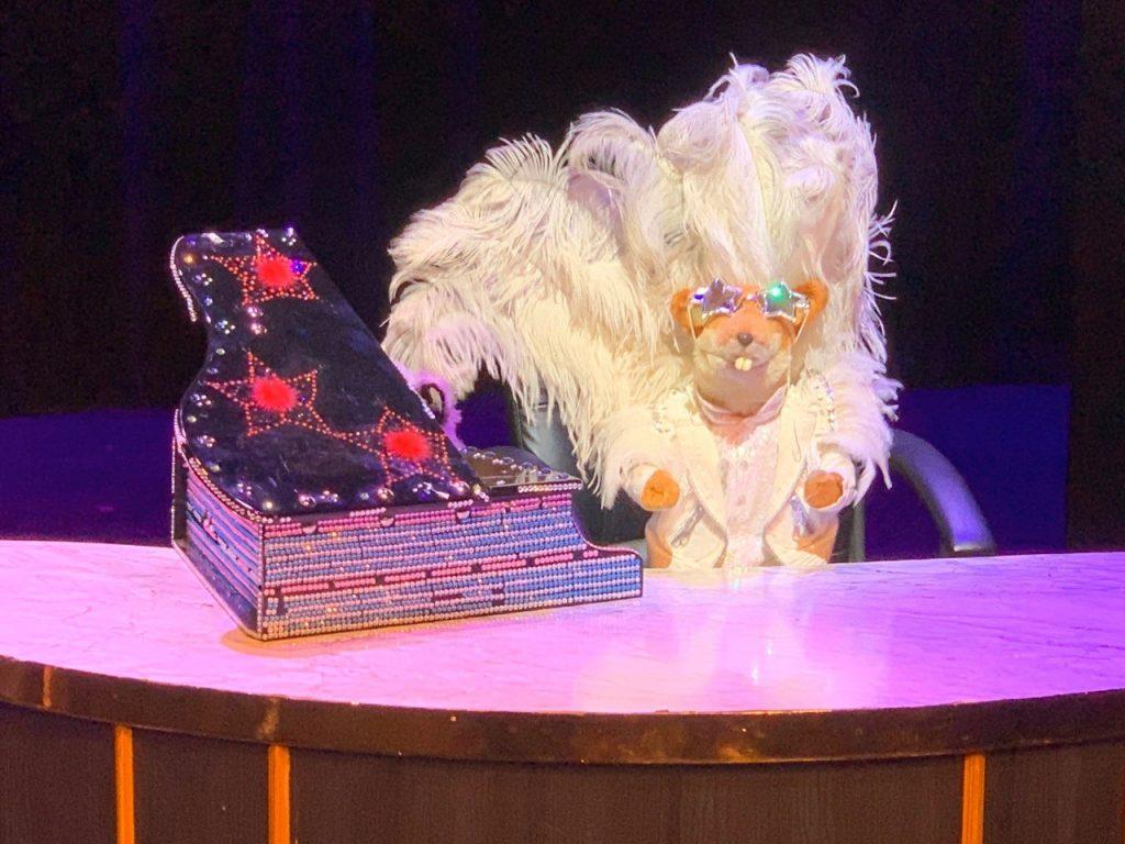 Basil Brush as Elton John
