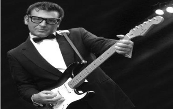 Alan Becks as Buddy Holly